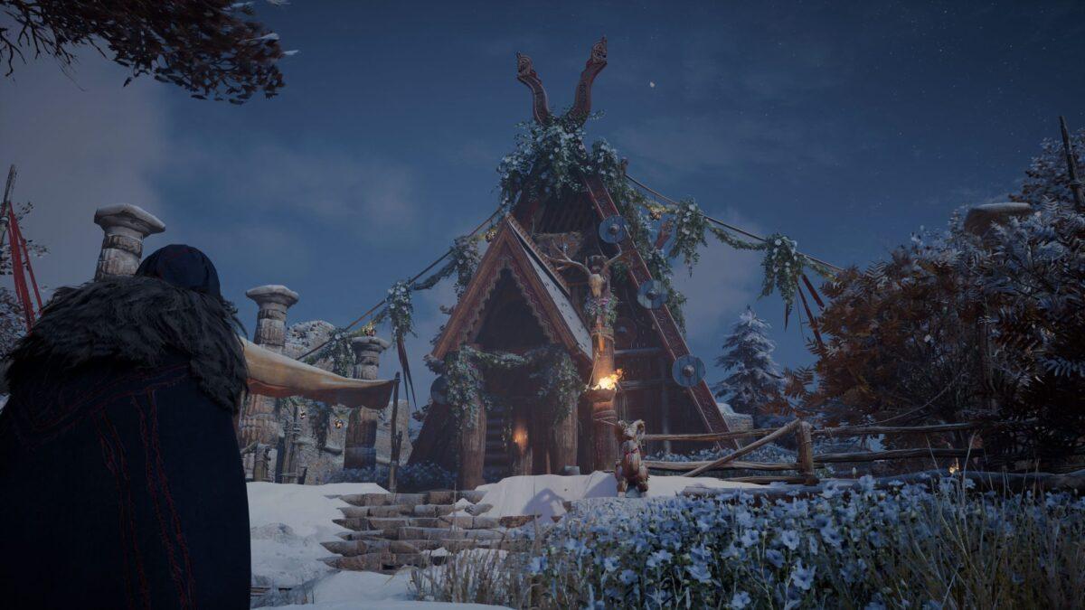 Eivor steht in Assassin's Creed Valhalla vor dem Haus des Beraters in Eoforwic.