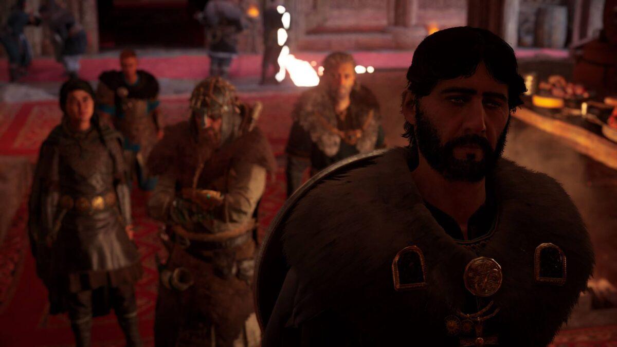 Eivor, Ljufvina und Hjör sprechen mit König Ricsige in Assassin's Creed Valhalla.