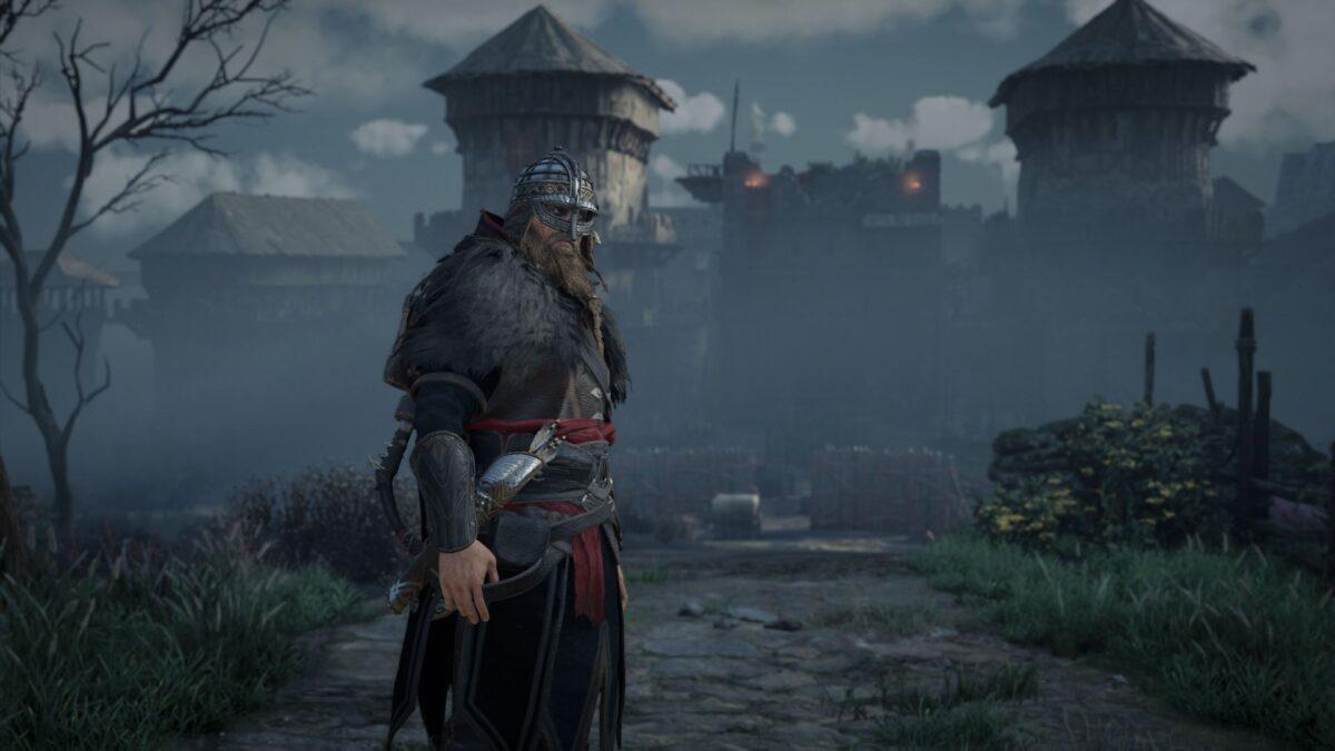 Wikinger Eivor steht in Assassin's Creed Valhalla vor den Toren von Portcaester.