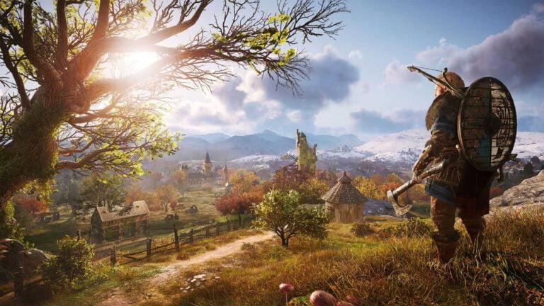 Wikinger Eivor blickt auf ein englisches Dorf in Assassin's Creed Valhalla.