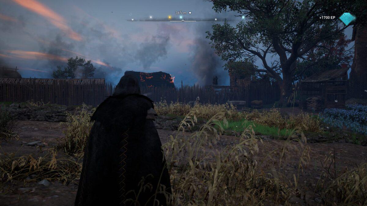 Eivor blickt auf das Dorf Waledene in Assassin's Creed Valhalla.