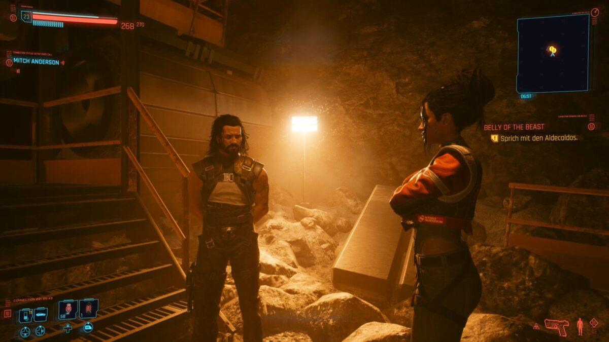 Panam und Saul diskutieren in Cyberpunk 2077 vor der Treppe zum SERK.