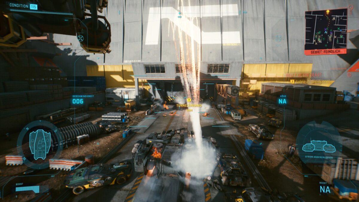 V und Panam sprengen das Tor zum Tunnel an der Maglev-Baustelle in Cyberpunk 2077 mit dem Basilisken auf.