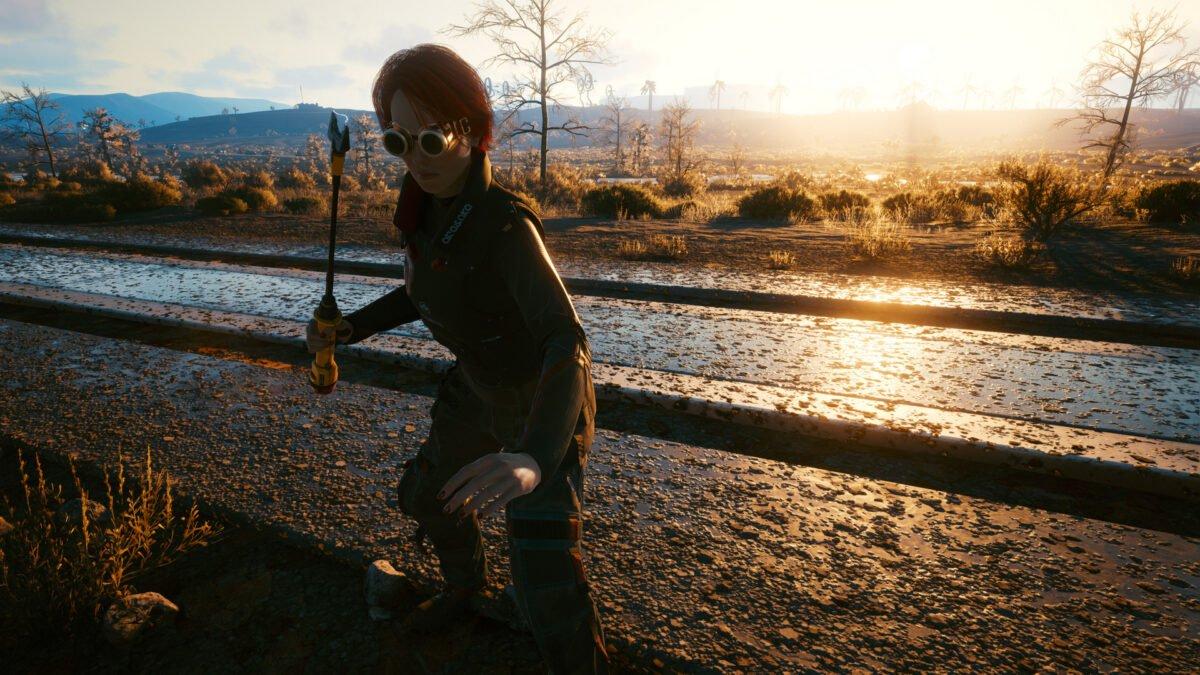 V hält die ikonische Waffe Tinker Bell in Cyberpunk 2077 in der Hand