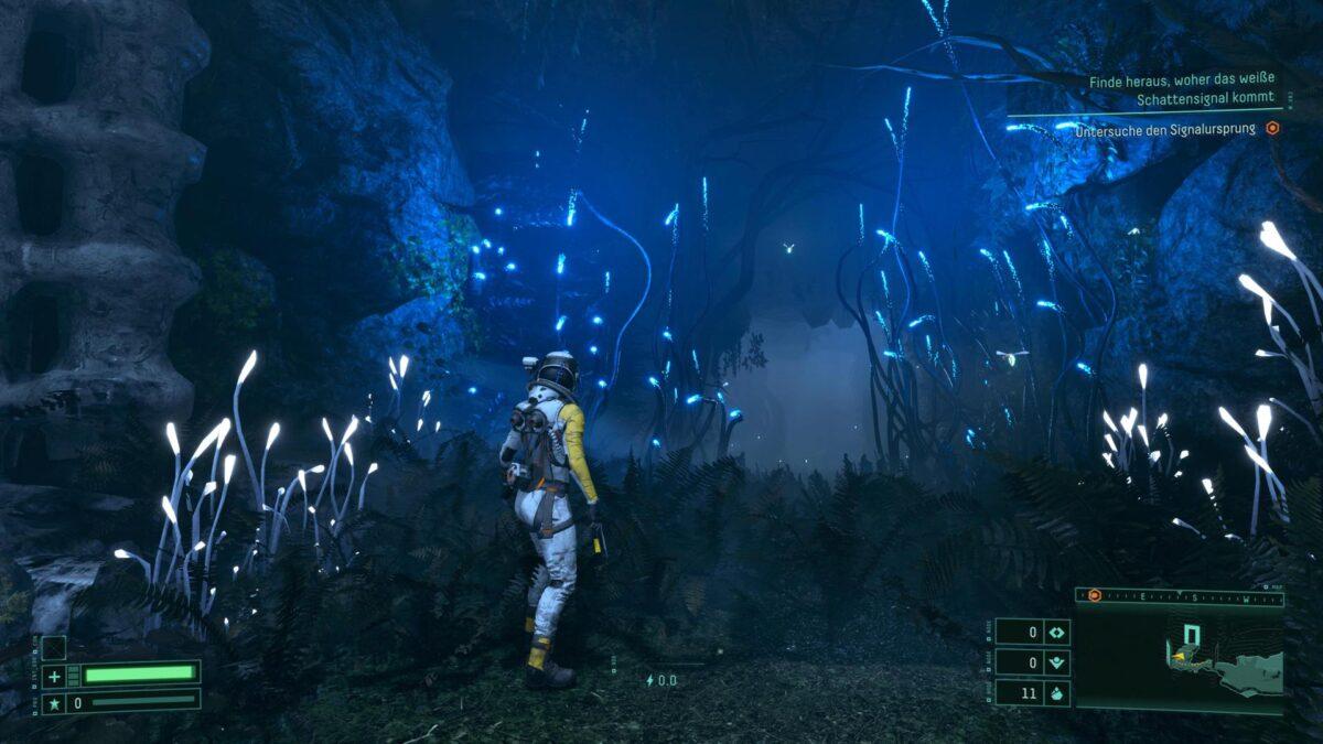 Selene traverses the overgrown ruins in Returnal.