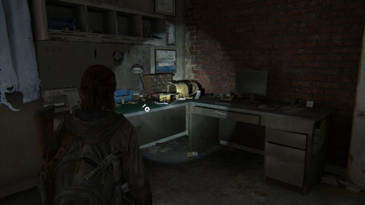 A desk and a workbench in the back room of the Martial Arts Center in Capitol Hill in The Last of Us 2.