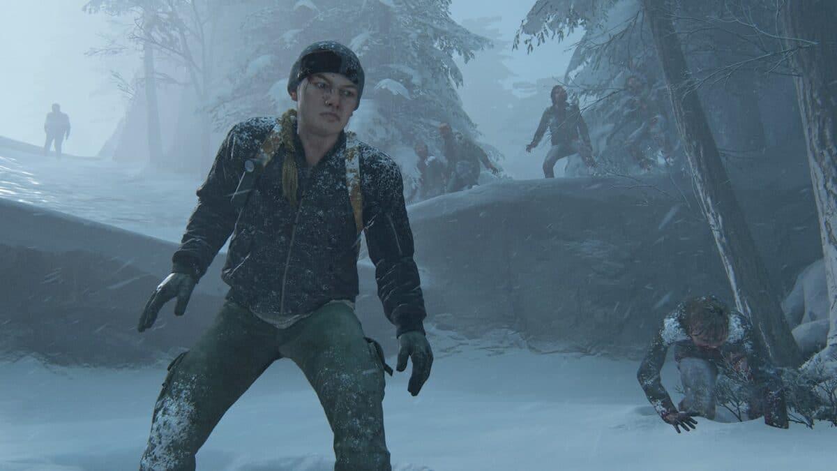 Die blutende Abby flieht vor einer Horde Infizierter durch eine verschneite Landschaft.
