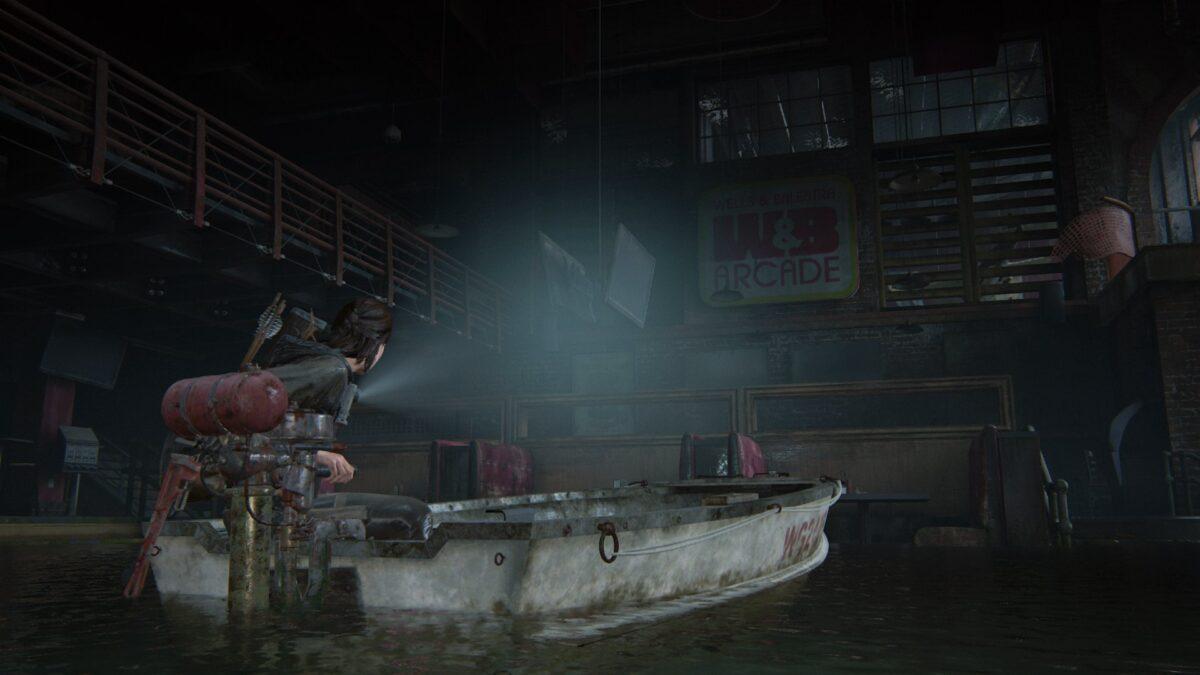 Ellie fährt in The Last of Us 2 mit einem Boot in eine überschwemmte Spielhalle.
