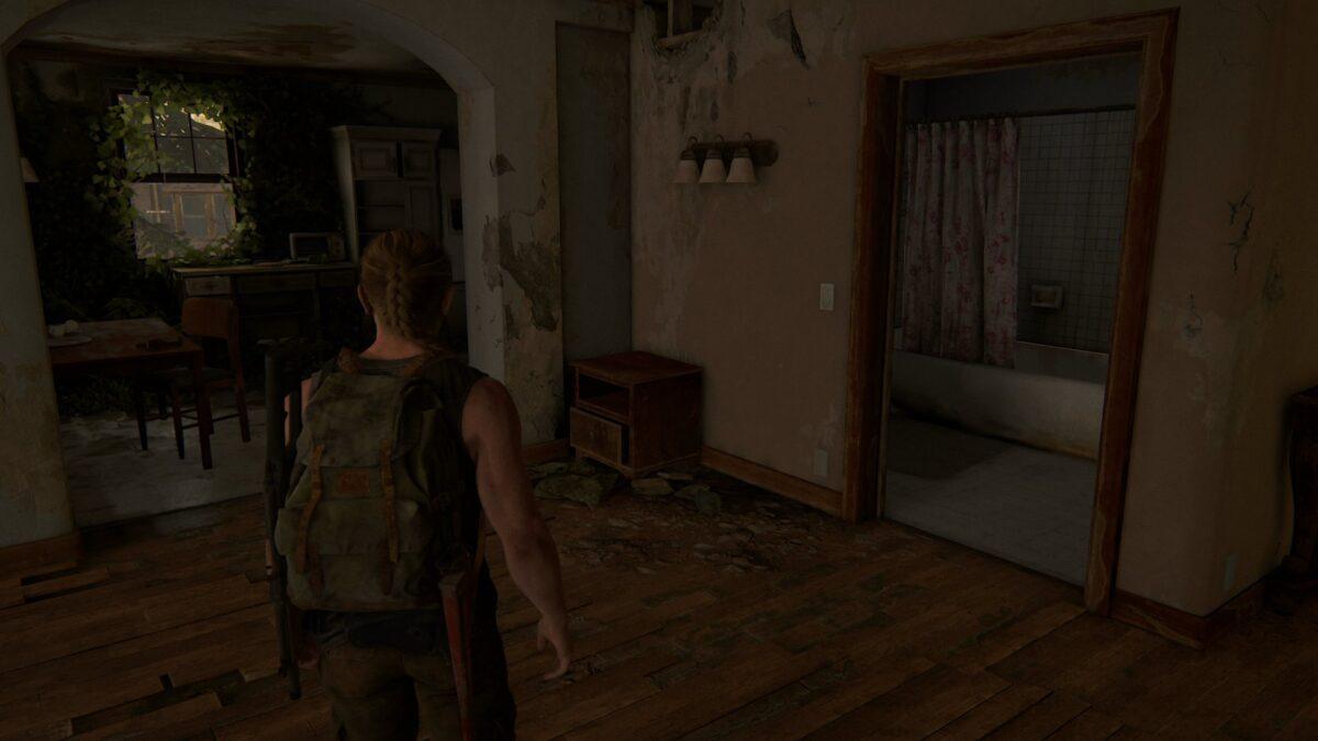Abby steht in The Last of Us 2 in einem verlassenen Apartment.