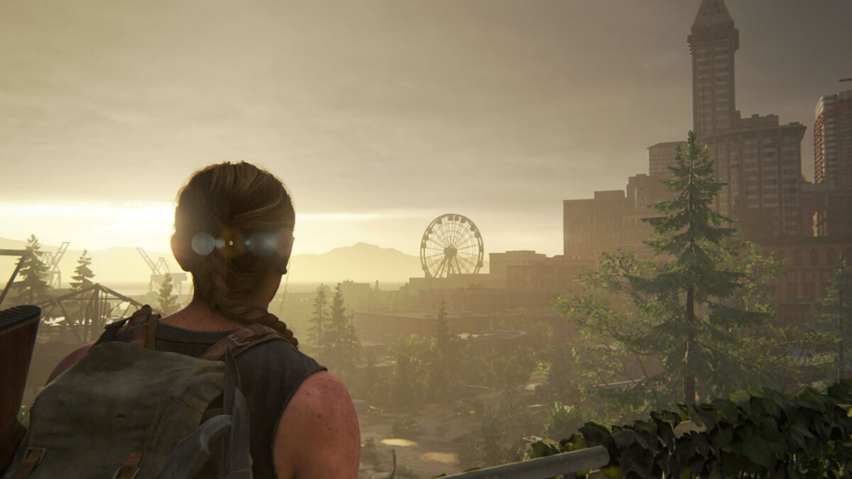 Abby erblickt in The Last of Us 2 das Riesenrad am Horizont.