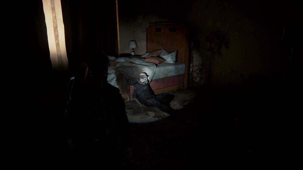 Abby findet in The Last of Us 2 eine Leiche mit Gasmaske.