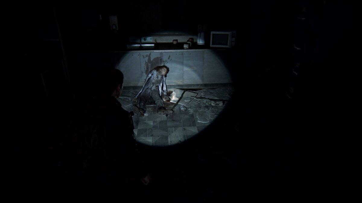Abby steht in The Last of Us 2 vor einer Leiche im Krankenhaus.