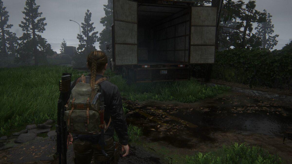 Abby steht in The Last of Us 2 vor einem Lkw auf der Insel.
