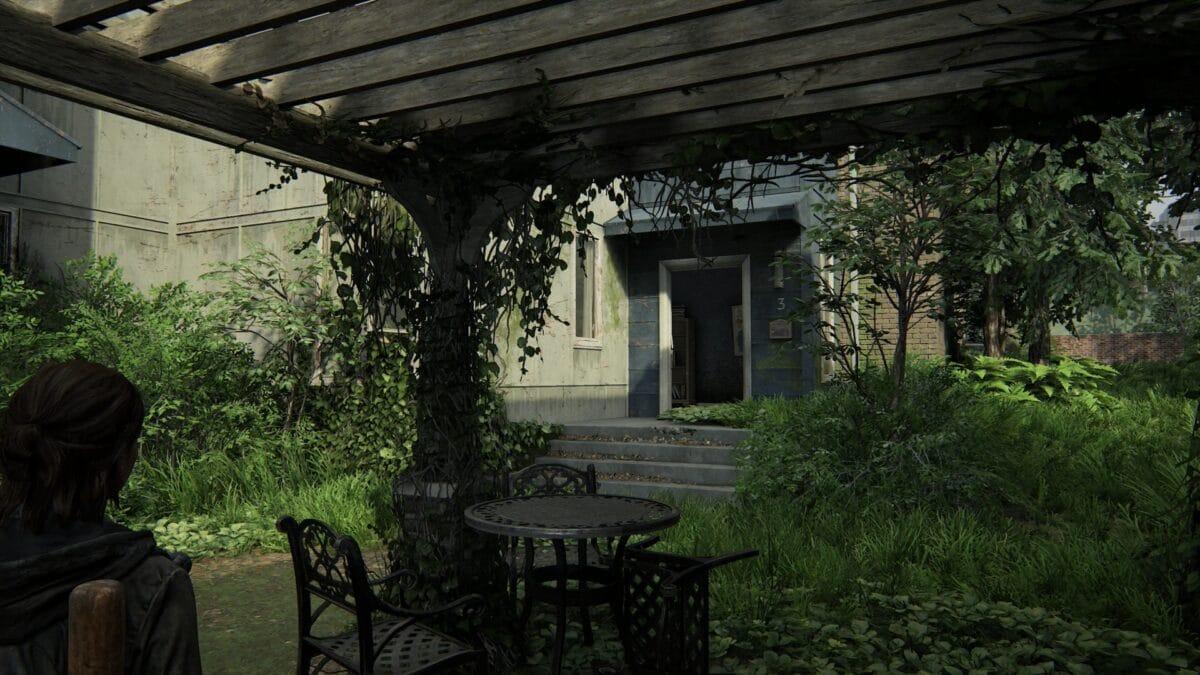 Sitzgelegenheit unter einem Vordach mit Blick auf Haus Nummer 3 in Capitol Hill in The Last of Us 2