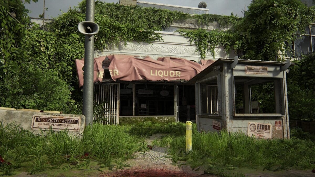 A liquor store with a guardhouse in front of it in The Last of Us 2.