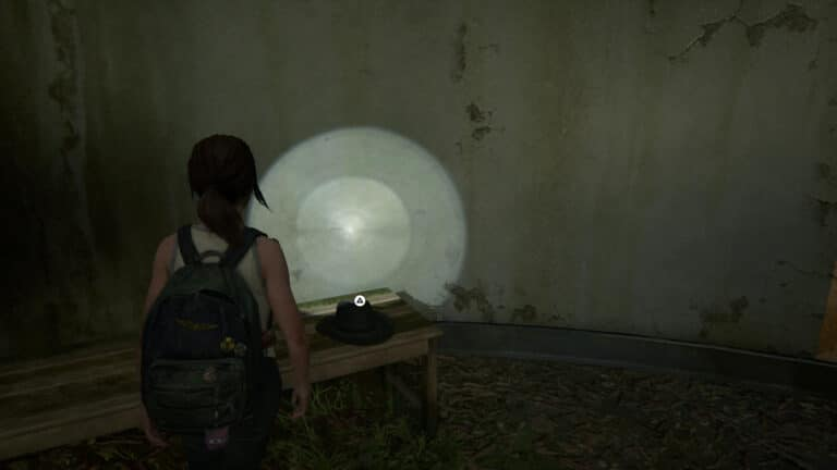 Another hat lies on the wooden bench in the showroom in The Last of Us 2.