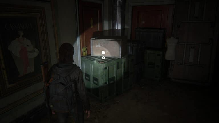 The artifact lies on the green crate outside the men´s room.