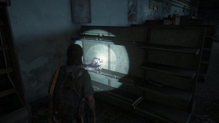 Die Sammelkarte Randy Styles neben einem Karten-Display in einem Regal eines Supermarkts in The Last of Us 2