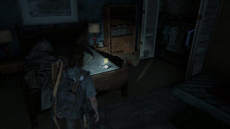 """Auf einem Bett liegt das Trainingsbuch """"Sprengstoff"""" in The Last of Us 2"""