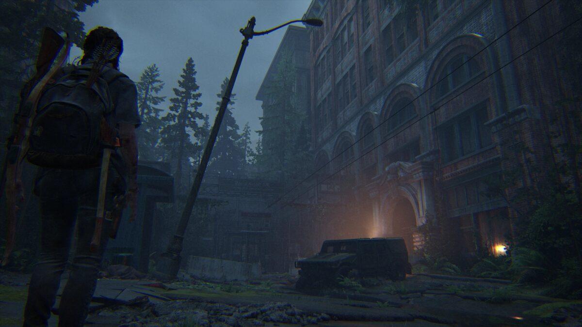Blick auf FEDRA-Fahrzeug rechts und Straßensperre dahinter in The Last of Us 2