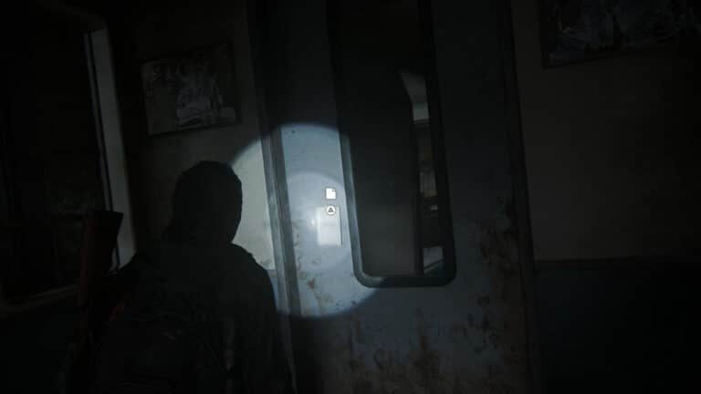The subway station note hangs on the door of the subway car.