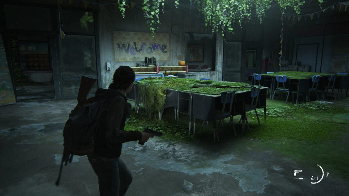 Ellie with a gun in a classroom at Eastbrook Elementary School in The Last of Us 2.