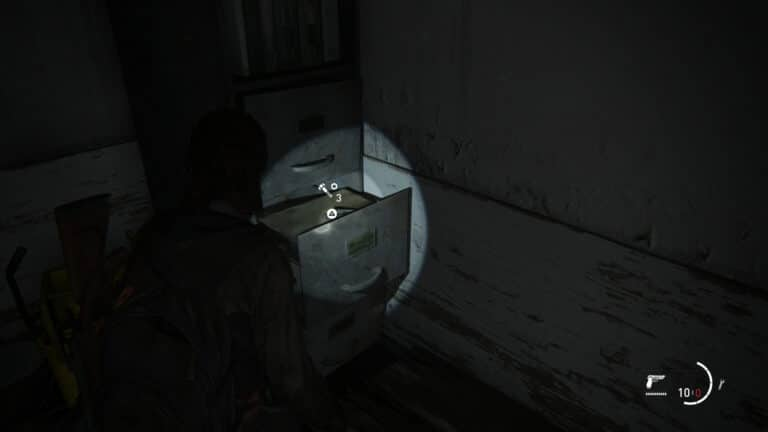 Upgrade parts inside a file cabinet in the passageway on the roof of Eastbrook Elementary School in The Last of Us 2.