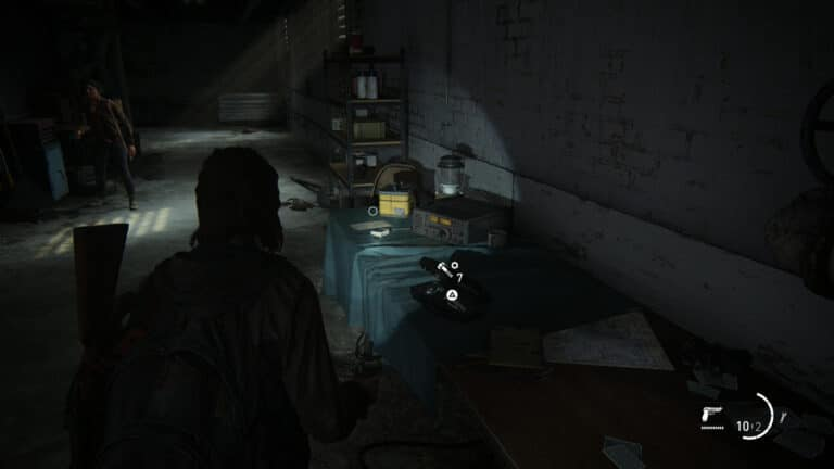 Upgrade parts on the table in the passageway from the roof of Eastbrook Elementary School in The Last of Us 2.