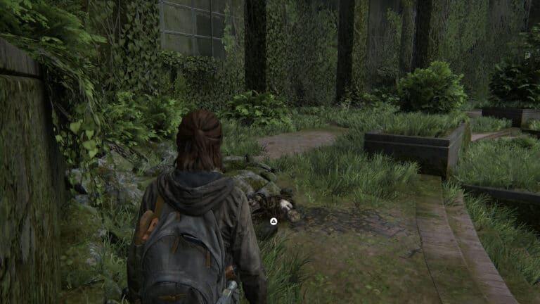 Unter einer Leiche unter Schutt liegt das Artefakt Brief von Isaac in The Last of Us 2