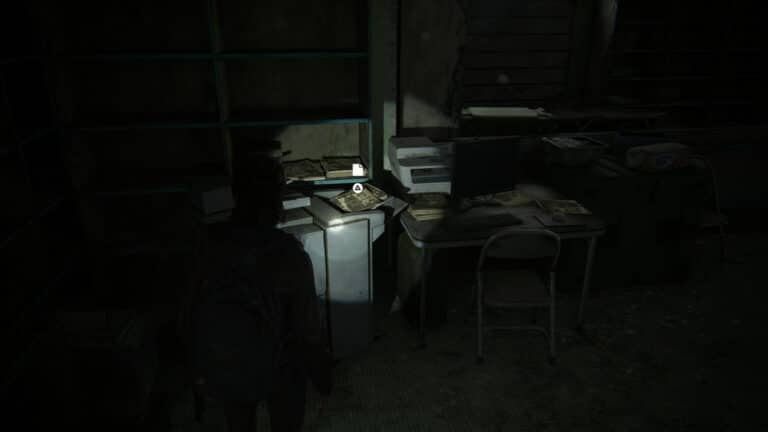 The artifact Join WLF Note lies on a copier in a dark room in The Last of Us 2.