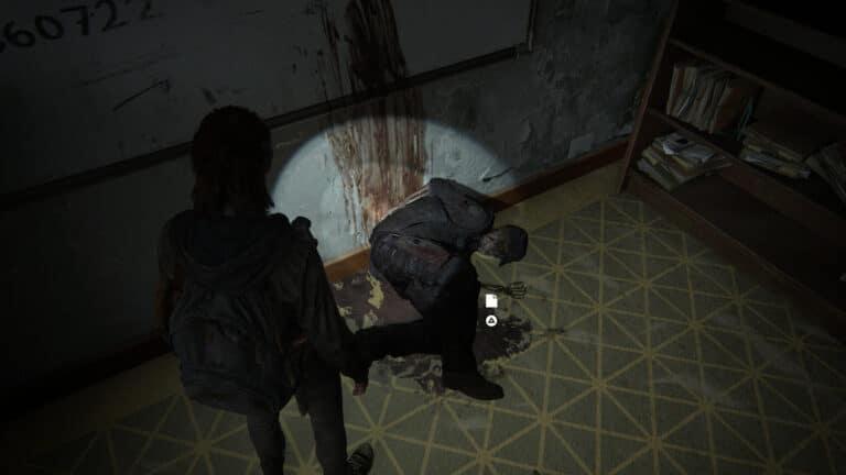 Bei einer Leiche liegt das Artefakt Letzter Bericht von Lt. Torres in The Last of Us 2