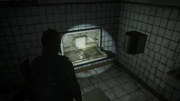 On the folding table in the toilet is the artifact Pet Store Key in The Last of Us 2.