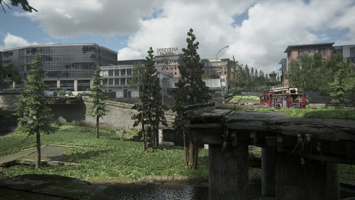 View over a destroyed highway in The Last of Us 2 with a fire truck on it
