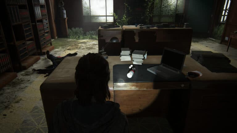 The supplements lie on the desk next to the laptop in the judge´s chambers in The Last of Us 2.