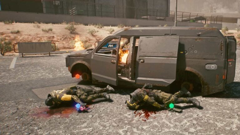 Cyberpunk 2077 Clothing Guide Two armored corpses next to a burning militech van