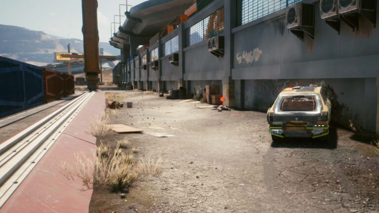 Cyberpunk 2077 clothing guide corpse lying in front of industrial building in alley behind containers, broken car in foreground
