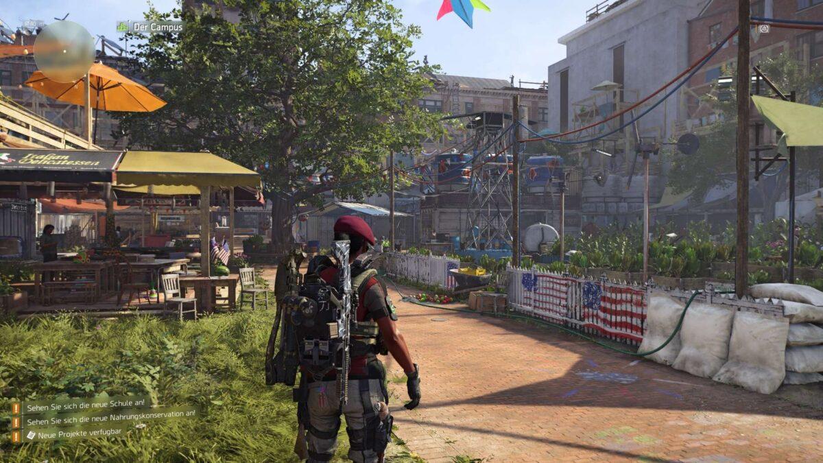 Eine Division-Agentin steht in einer wieder aufgebauten Siedlung.
