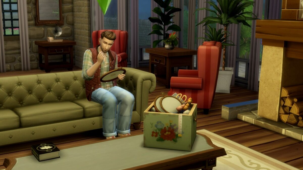 Sims 4 Landhaus-Leben Guide Sim sitzt auf Sofa und stickt in Rahmen