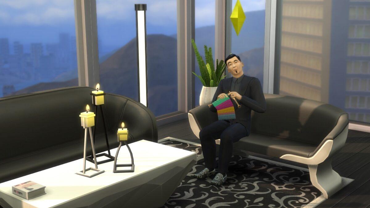 Geschäftsmann strickt auf Sofa in Penthouse